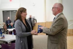 Barbara Van Duren accepts special gift of flags from Mayor Jack Poll.