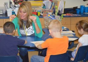 Kindergarten teacher Holly Vostad with students