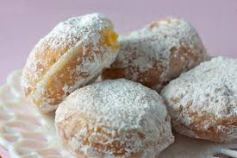 Marge's Donut Den offers 12 varieties of Paczkis with powdered or glazed topping.