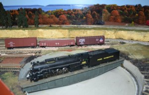 Ken's model railroad uses the latest technology for the hobby.