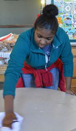 Crossroads student Brakezia Sylvester cleans a table.