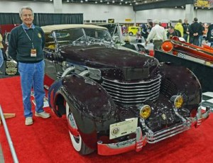 Huron Township resident Charlie Saganek stands with his 1937 Cord Phaeton at the recent Autorama in Detroit. Photos by Dave Chapman