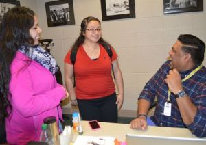 Duane Bacchus shares a laugh with seniors Jessica Garcia and Maria Ramirez
