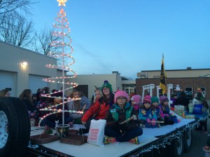 Girls Scouts from the Byron Center area ride on the float in the Byron Center Christmas parade.