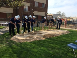 "Kelloggsville school officials and representatives ""break ground"" on the district's high school renovation project."