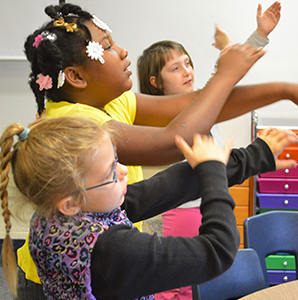"Students ""arm spell,"" a multi-sensory approach that helps them remembers sounds"