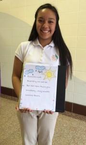 "San Juan Diego Academy Seventh Grader Nurit Gonzalez with her winning poetry piece ""April."""