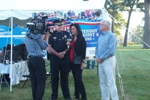 Wyoming Police Chief James Carmody and Wyoming Mayor Jack Poll are interviewed by WOOD-TV's Eva Aguirre for National Night Out.