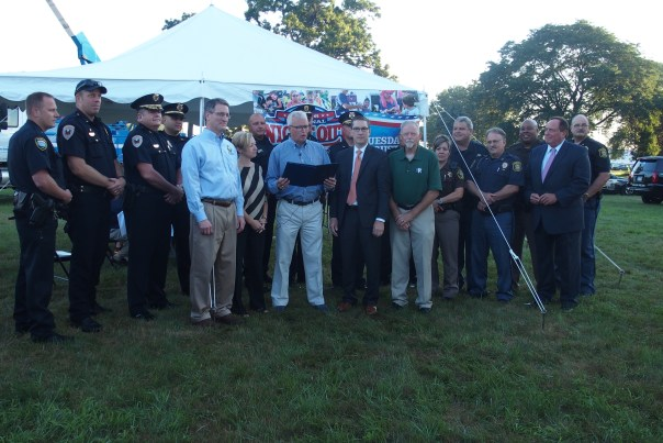 Mayors from the communities of Kentwood, Grand Rapids, Wyoming, Walker and Rockford attend the National Night Out kick-off event at Consumers Energy. Police officers from the various municipalities also were on hand.