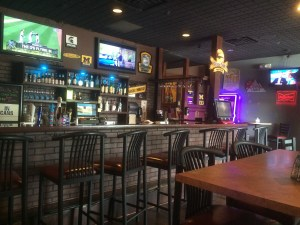The bar at 616 Sports Bar & Grill is located in the back.