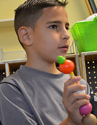 Fourth-grader David Espinoza, who is from Cuba, uses beads that correspond to questions to grow his vocabulary.