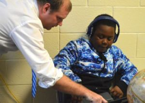 Teacher Joe Marsiglia works with seventh-grader Teron Collier, who has made huge gains in SWAS.