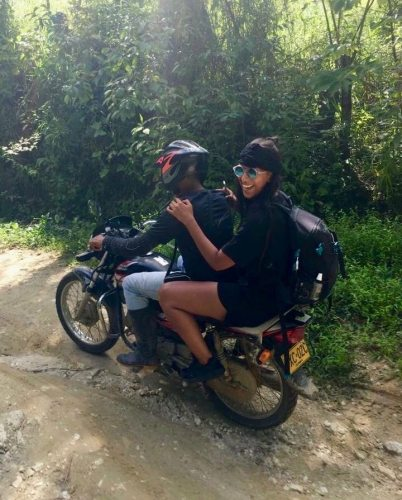 Naomi rides up a mountain on a motorcycle in Minca, Colombia