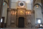 The main entrance to the duomo, with a 24-hour clock.