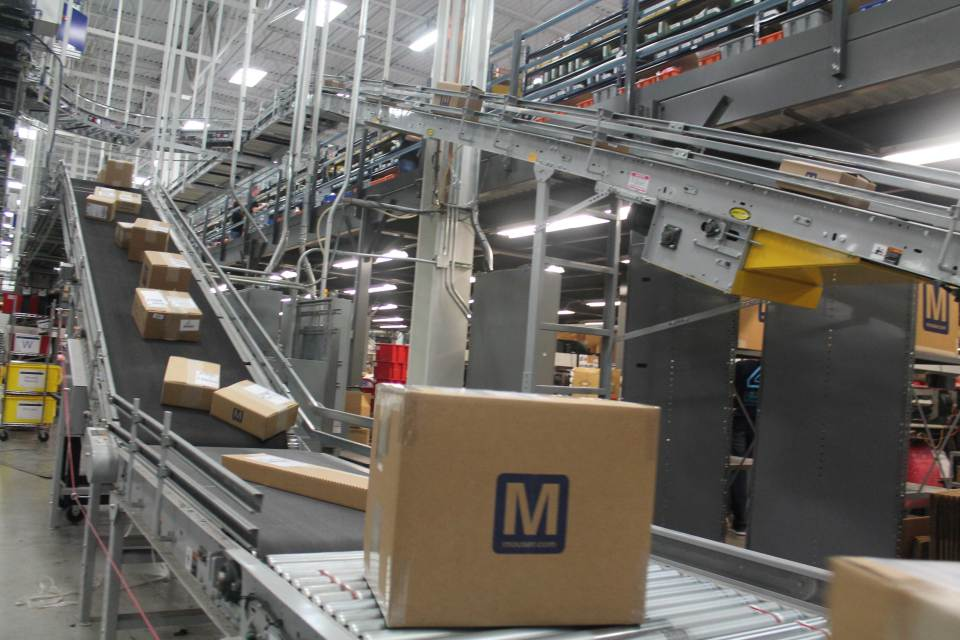 Photo of box on conveyor belt.