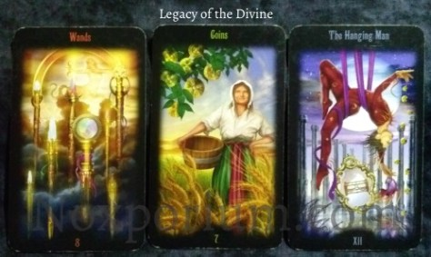 Legacy of the Divine: 8 of Wands, 7 of Coins, & The Hanging Man.