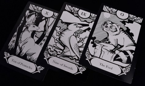 The Ten of Pentacles, Nine of Swords, and The Fool from The Animalis Os Fortuna Tarot Deck ©Megan Weber