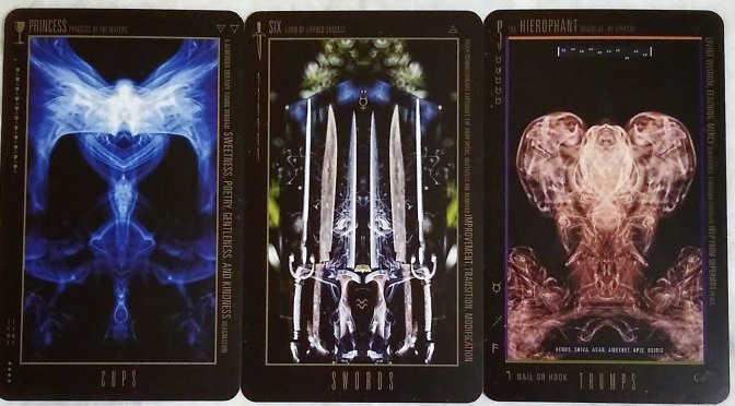 Wyzard of Odd: Princess of Cups, Six of Swords, & The Hierophant.