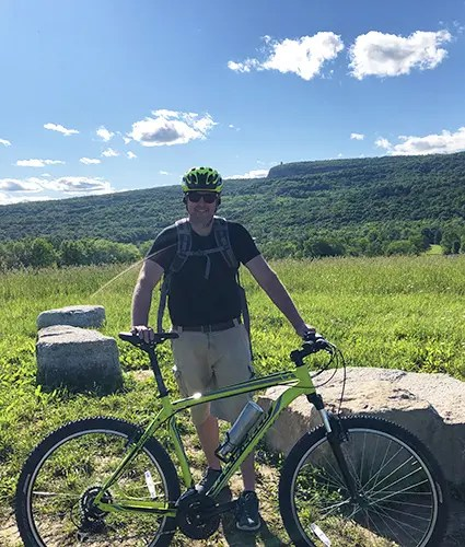 photo of Craig Chapman on a bike on the Mohonk Preserve Bike Trip in New Paltz