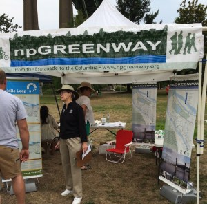 npGreenway board member Pam Arden talks to folks at the Willamette River Revival in Cathedral Park, August 2015.