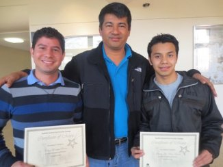 """Celson and Jacinto receiving their """"top student"""" awards for excellence in their ESL courses!"""
