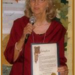 """Faye Tessnow receiving """"Chapter of the Year"""" award. Photo by Bill Hopkins"""
