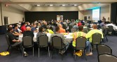 Excavators listen to damage prevention safety presentations.