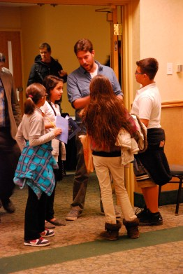 Group of elementary students asking GDPE graduate student Dave Hoover questions.