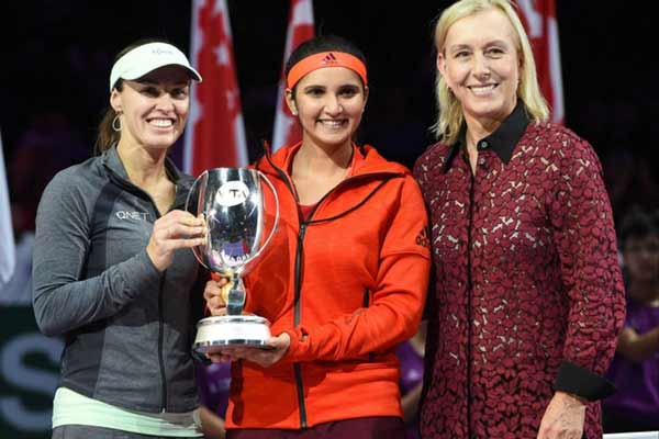 Sania, Martina grabs WTA Finals doubles title