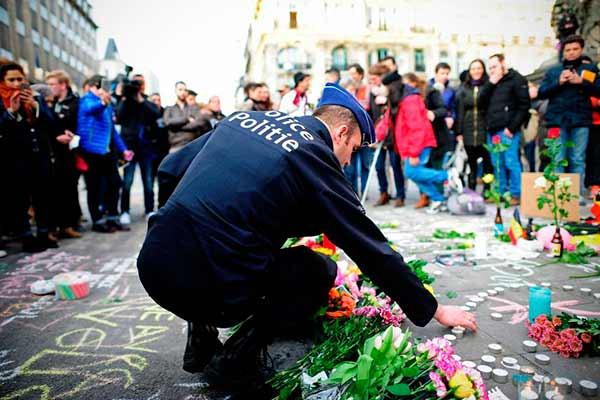 EU pledges to better share information on terrorism after Brussels attacks