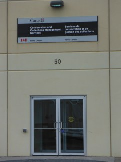 The front door of the Parks Canada Archaeology Lab at 50 Neptune Crescent, Woodside (Dartmouth), Nova Scotia. Parks Canada Agency is planning to close this facility and move archaeological collections and staff to Gatineau, Québec. Credit: Nova Scotia Archaeology Society