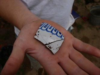 Fragments of an 18th century ceramic container made of tin-glazed earthenware. Vessels like these, which were imported to the region from Europe during the early colonial period, offer dating evidence and also provide information about trade and status. Credit: Jonathan Fowler