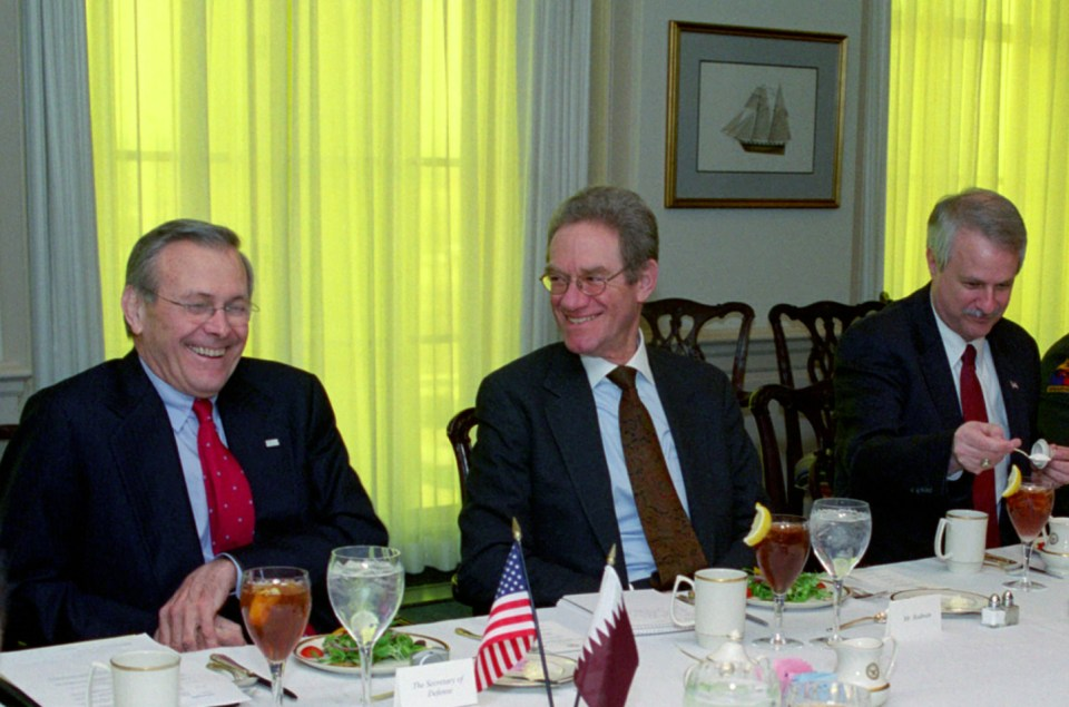 Donald H. Rumsfeld (left) shares a laugh with Peter W. Rodman (center)