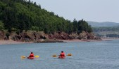 Paddlers enjoy a bright summer day off Partridge Island.