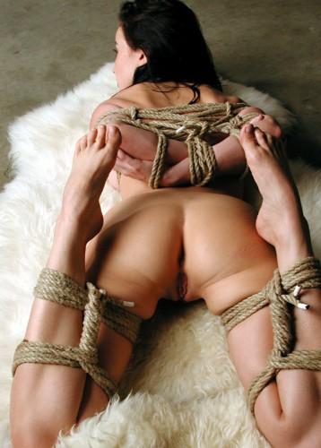 leg bound on a fur rug