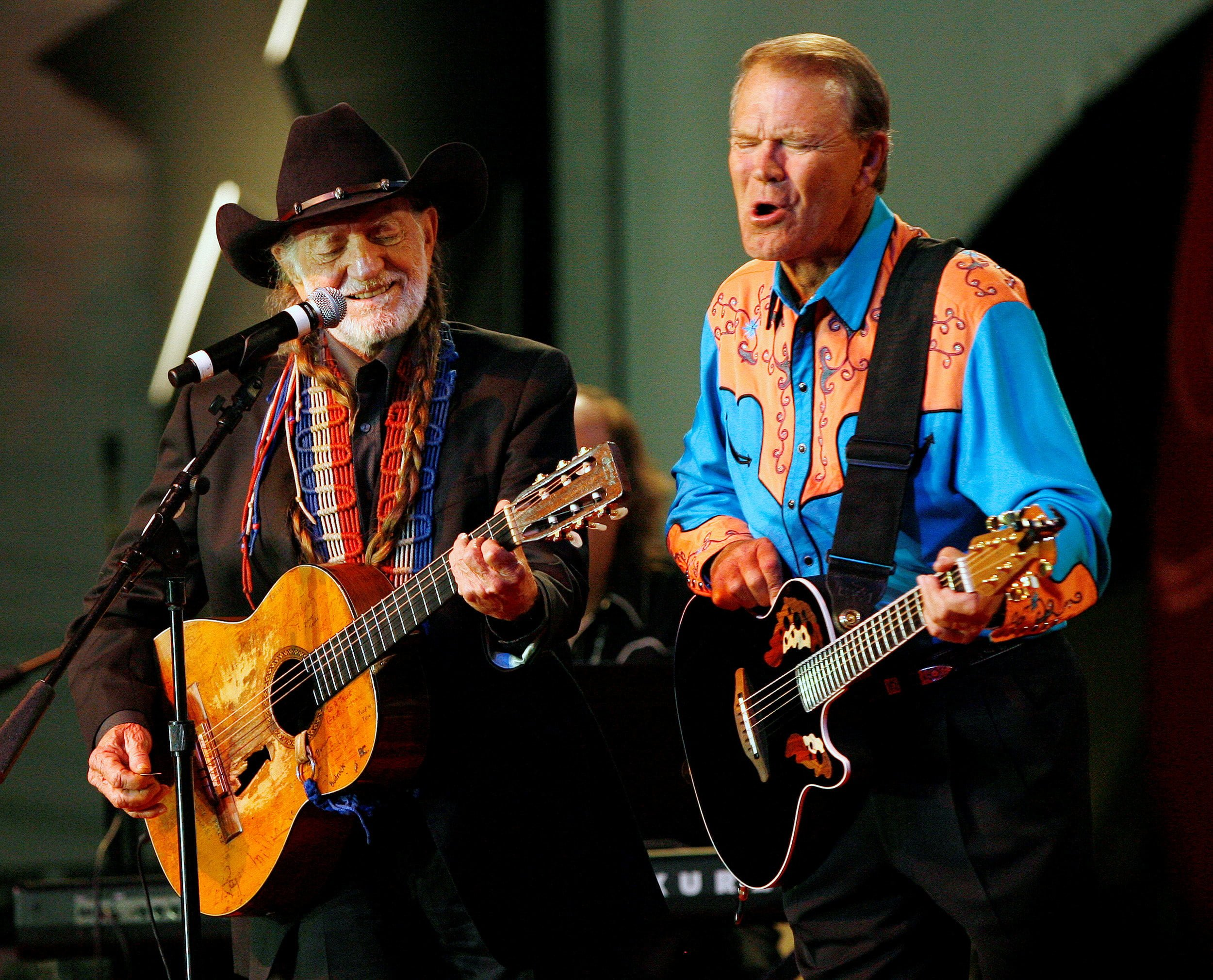 FILE PHOTO – Willie Nelson and Glen Campbell perform on stage at the 20th Autry National Center gala at the Gene Autry Western Heritage museum in Los Angeles