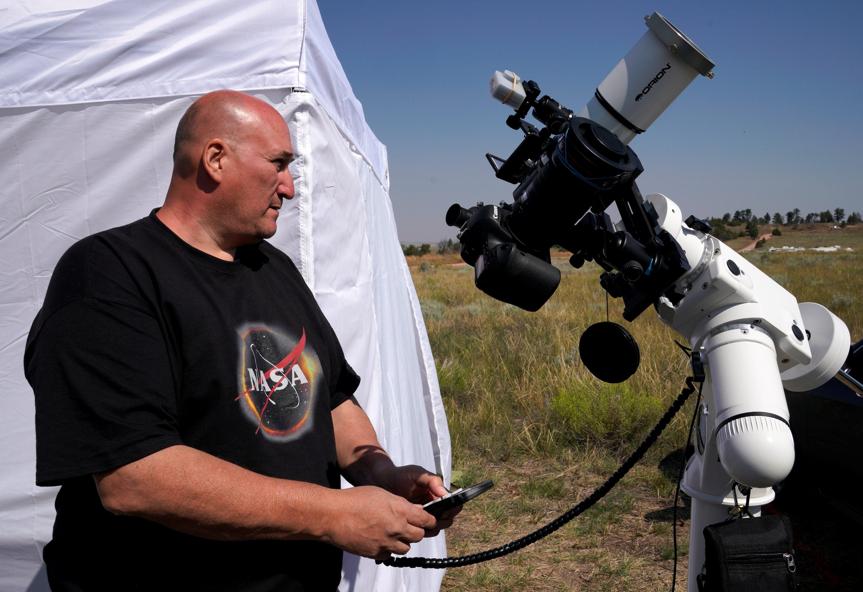 Rick Roty works with his telescope in a designated eclipse viewing area in a campground near Guernsey, Wyoming, U.S., August 20, 2017.