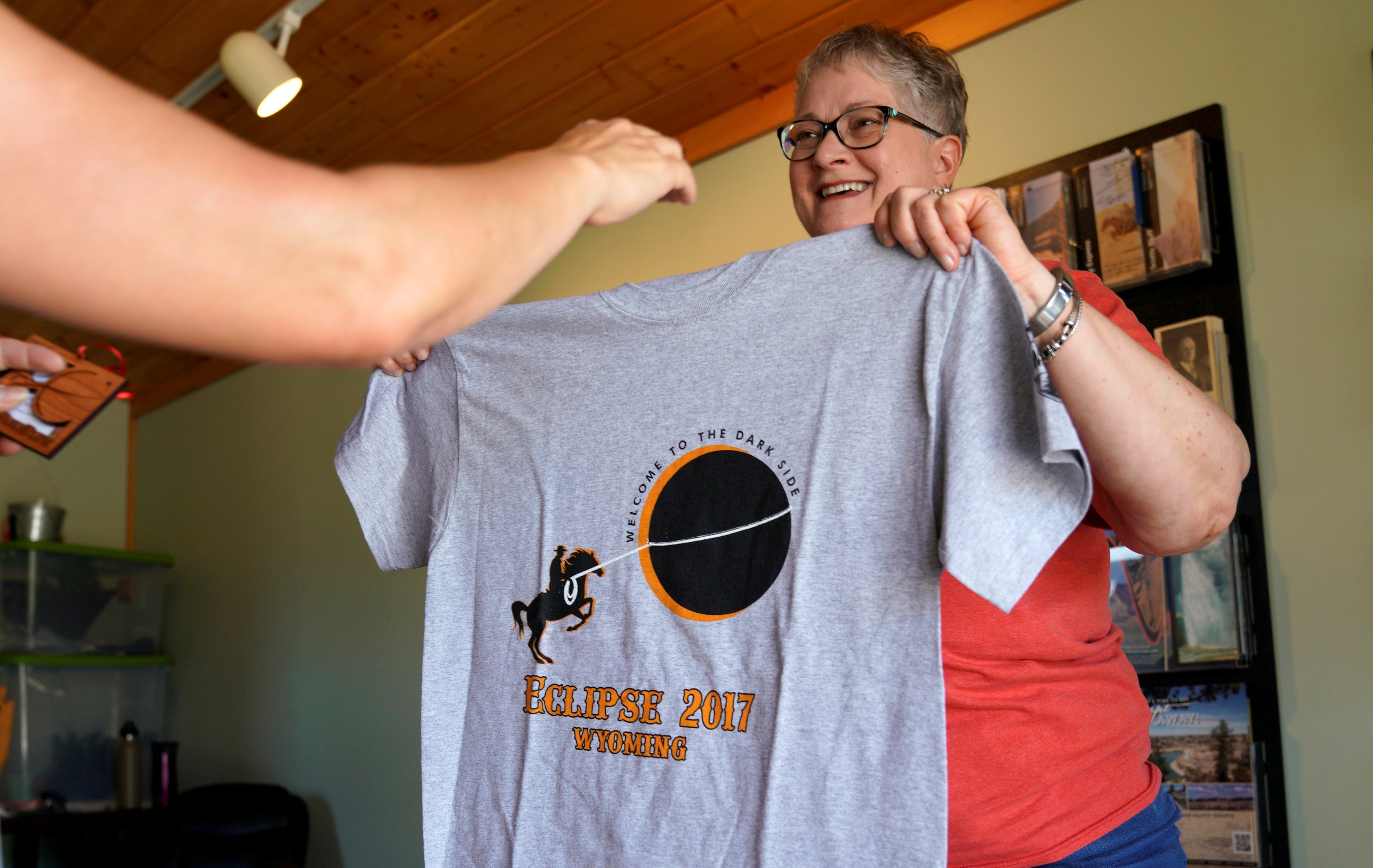 Sue Martindale displays an eclipse t-shirt for sale in Guernsey, Wyoming U.S. August 20, 2017. REUTERS/Rick Wilking NO RESALES. NO ARCHIVES.