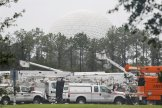 The 'Spaceship Earth' dome looms above a fleet of utility trucks parked in a parking lot at Disney's Epcot theme park ahead of the arrival of Hurricane Irma in Kissimmee, Florida, U.S., September 10, 2017. REUTERS/Gregg Newton