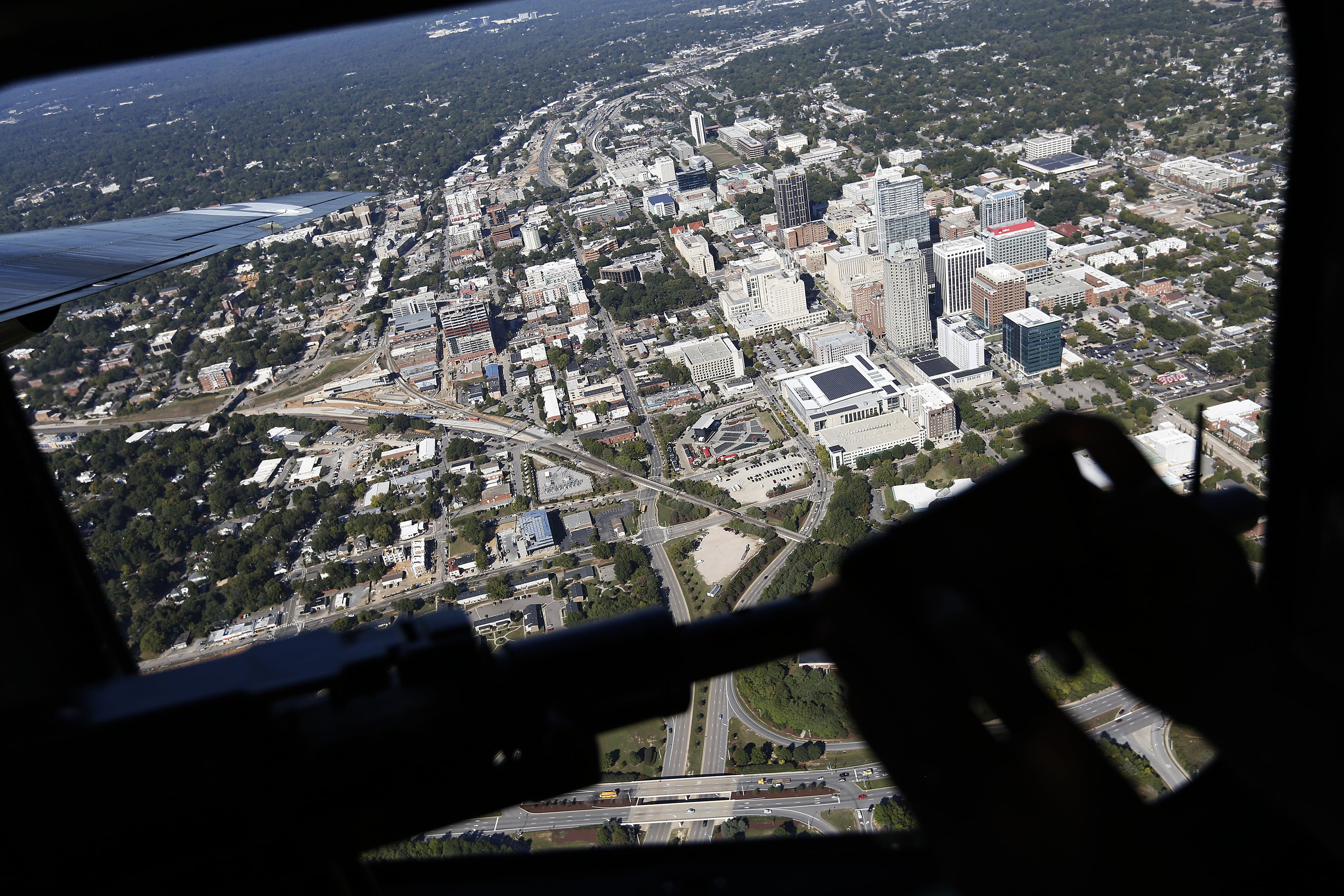 The world's only flying B-24J Liberator soars over downtown Raleigh after taking off at Raleigh-Durham International Airport during the Wings of Freedom Tour, October 19, 2017. Hosted by the Collings Foundation, Wings of Freedom visits more than 100 cities a year to show off working pieces of American war history as well as to educate people about the veterans of WWII. The tour will be in Burlington, NC until 12 pm on Oct. 25 and then move to Statesville, NC through Oct. 27. (Eamon Queeney / North State Journal)