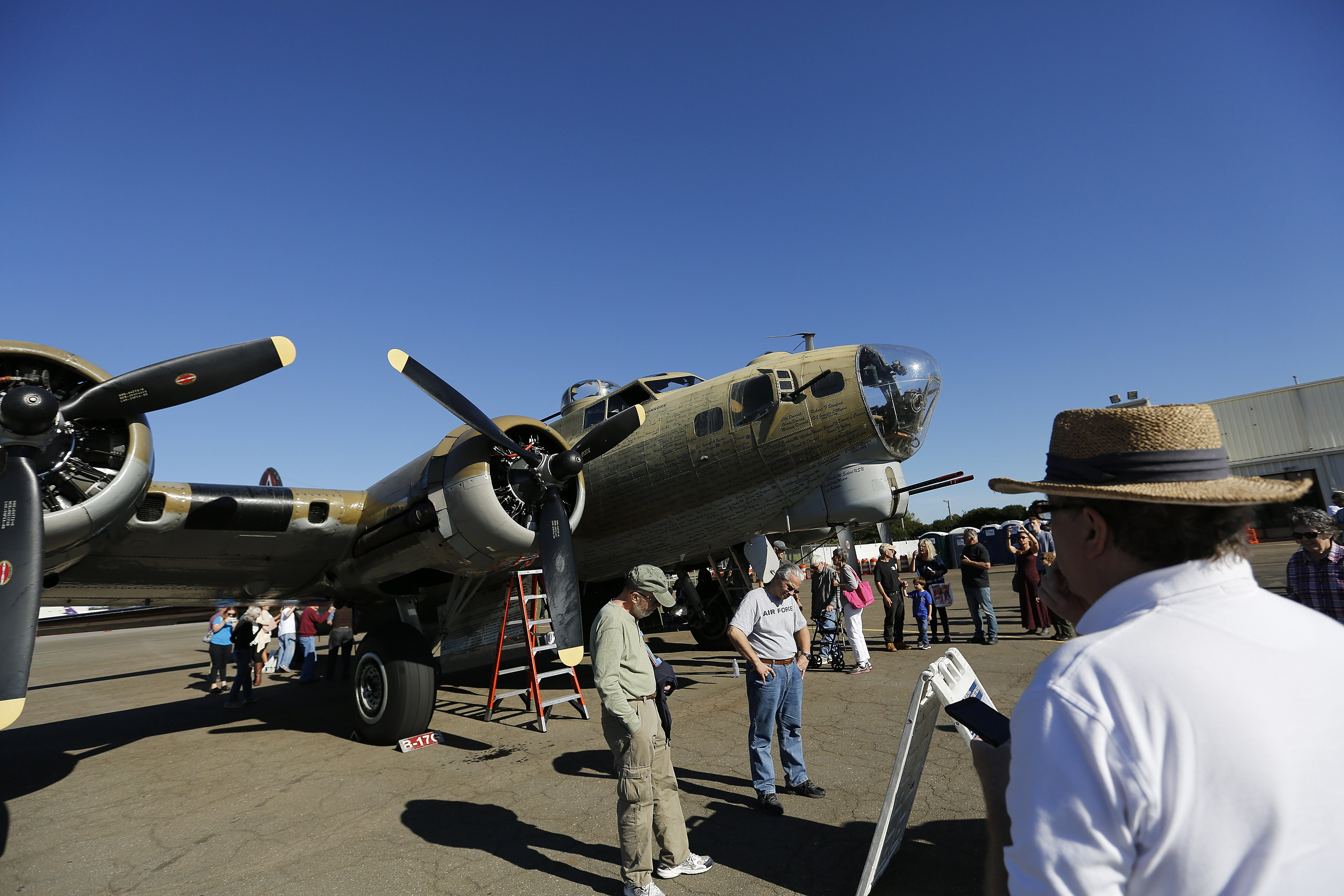 People examine a B-17 Flying Fortress during the Wings of Freedom Tour at Raleigh-Durham International Airport, October 19, 2017. Hosted by the Collings Foundation, Wings of Freedom visits more than 100 cities a year to show off working pieces of American war history as well as to educate people about the veterans of WWII. The tour will be in Burlington, NC until 12 pm on Oct. 25 and then move to Statesville, NC through Oct. 27. (Eamon Queeney / North State Journal)