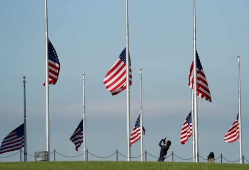 Flags are at half staff to honor those killed and injured in the Las Vegas mass shooting at the Washington Monument in Washington, U.S., October 3, 2017. REUTERS/Kevin Lamarque