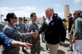 U.S. President Donald Trump greets members of the U.S. military as he prepares to board Air Force One, to survey hurricane damage, at Muniz Air National Guard Base in Carolina, Puerto Rico, October 3, 2017. REUTERS/Jonathan Ernst