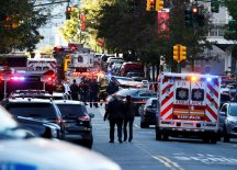 A Home Depot truck which struck down multiple people on a bike path, killing several and injuring numerous others is seen as New York city first responders are at the crime scene in lower Manhattan in New York, NY, U.S., October 31, 2017. REUTERS/Brendan McDermid