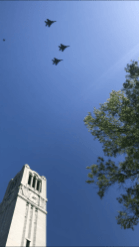F-15 fighter jets from the 335th squadron based at Seymour Johnson Air Force base in Goldsboro fly in the Missing Man formation over the N.C State Memorial Bell Tower on May 1, 2018. North State Journal