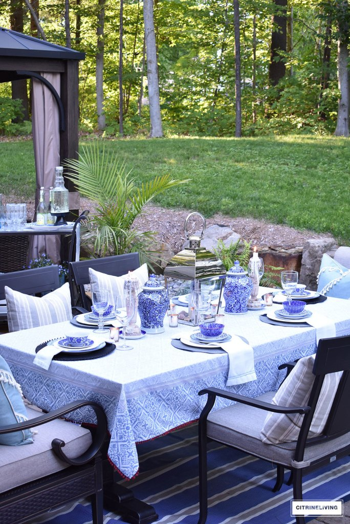 outdoor tablescape summer blue and white dishes and ginger jars