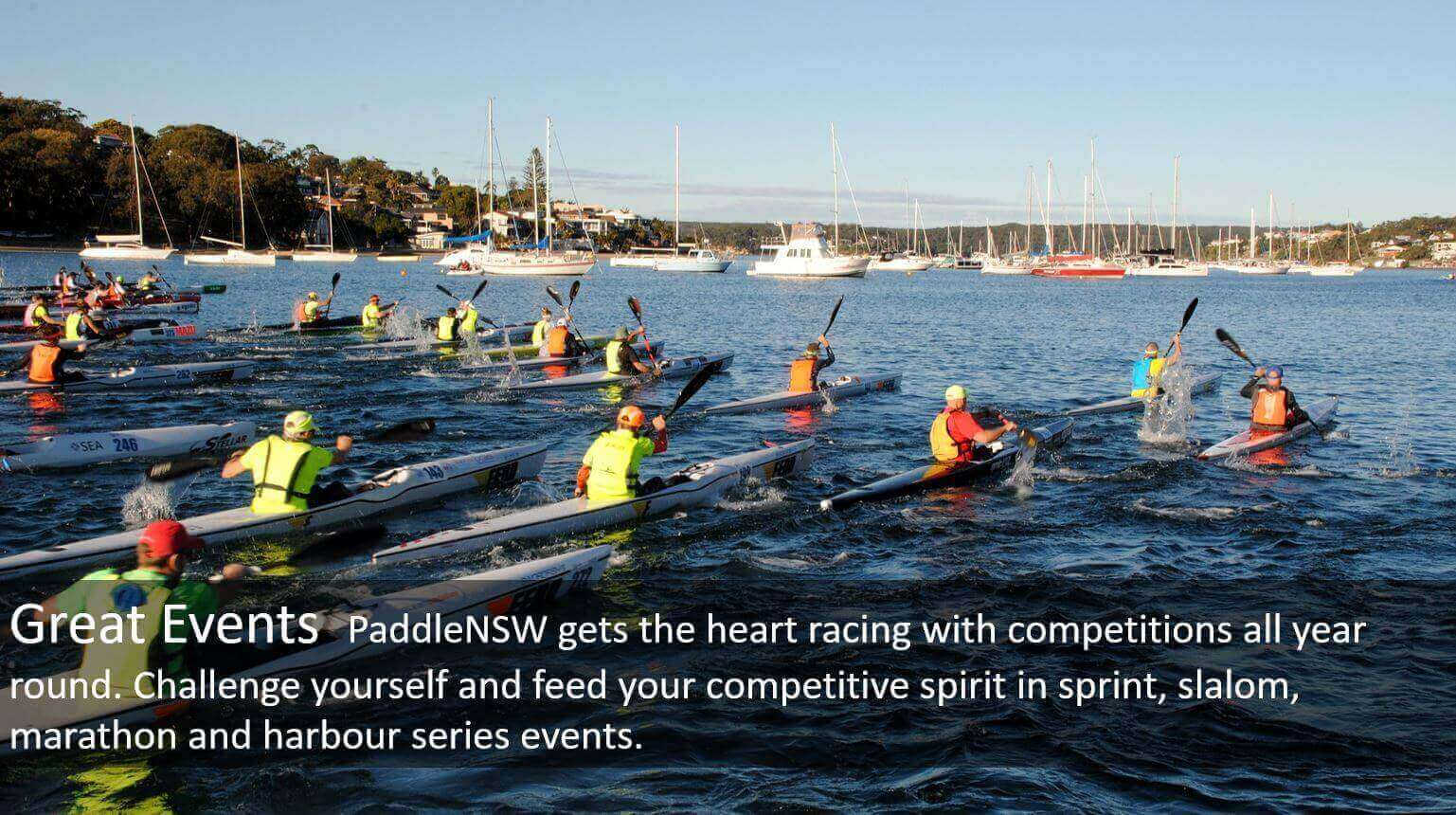 Mass start of ski paddlers in harbour series race, with text on Great Events