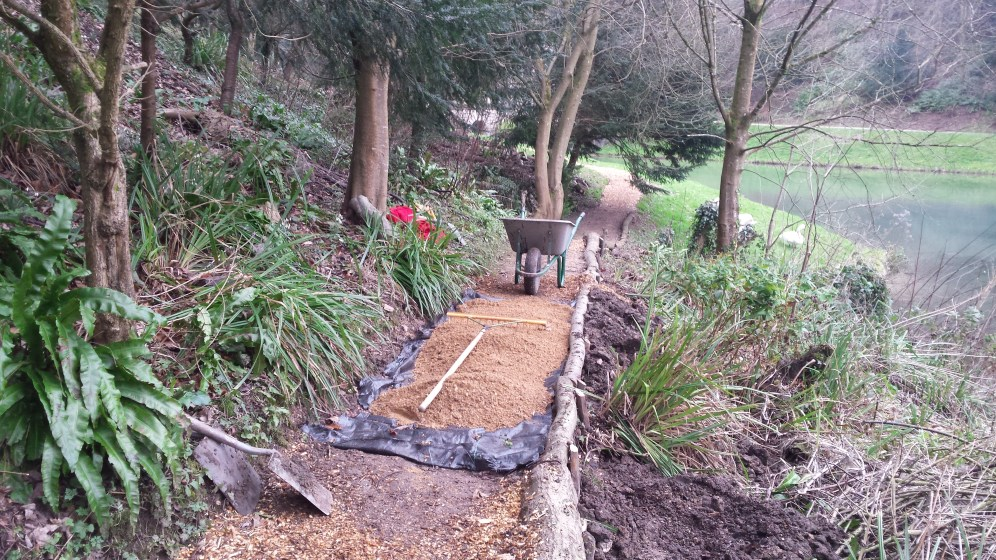 Resurfacing a section of path along the bank of the lake in Prior Park