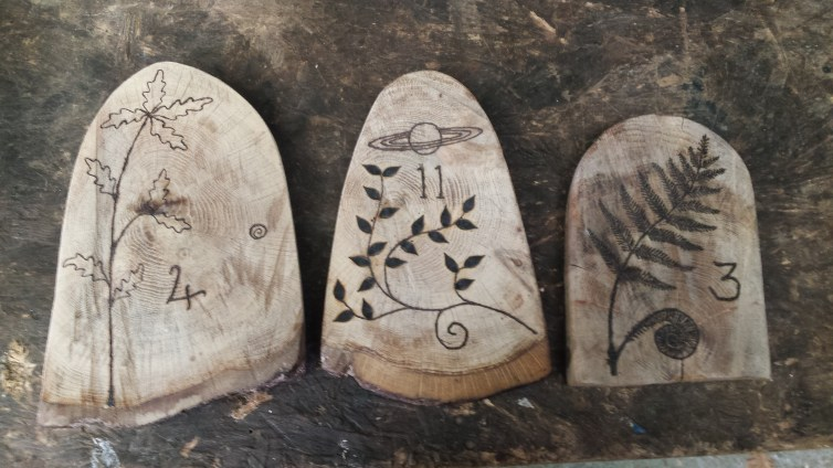 Some of the finished pyrography on the fairy doors.