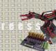 Imagen de un pequeño robot y una placa de electrónica